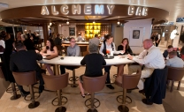 Guests aboard the Carnival Horizon enjoy custom-crafted cocktails at the ship's Alchemy Bar. Photo by Andy Newman/Carnival Cruise Line