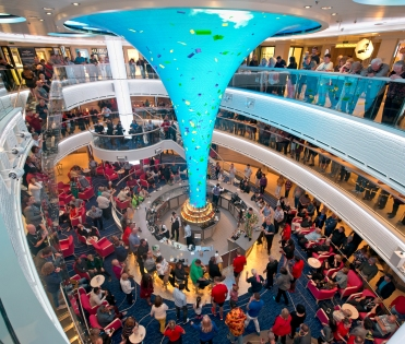 Guests aboard Carnival Horizon enjoy Mardi Gras night in the cruise liner's main atrium highlighted by the Dreamscapes LED sculpture. Photo by Andy Newman/Carnival Cruise Line