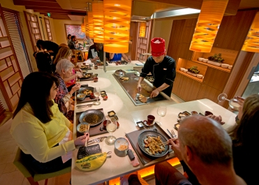 Guests aboard the Carnival Horizon enjoy dinner at Bonsai Teppanyaki offering a menu of authentic delicacies from the Far East prepared by highly skilled chefs creating dishes on custom-built stations that form the center of the venueÕs two eight-seat tables. Photo by Andy Newman/Carnival Cruise Line