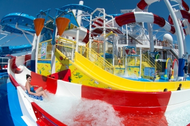 A guest slides down the Cat in the Hat water slide, that is a facet of the Dr. Seuss WaterWorks Park onboard the Carnival Horizon. Photo by Andy Newman/Carnival Cruise Line