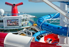 A young girl slides down the Cat in the Hat water slide, one of two that is a facet of the Dr. Seuss WaterWorks Park onboard the Carnival Horizon. Photo by Andy Newman/Carnival Cruise Line