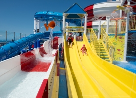 Kids race down short water slides that are part of the Dr. Seuss WaterWorks Park onboard the Carnival Horizon. Photo by Andy Newman/Carnival Cruise Line