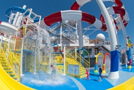 A 150-gallon tipping bucket dumps water at the Dr. Seuss WaterWorks Park onboard the Carnival Horizon. Photo by Andy Newman/Carnival Cruise Line