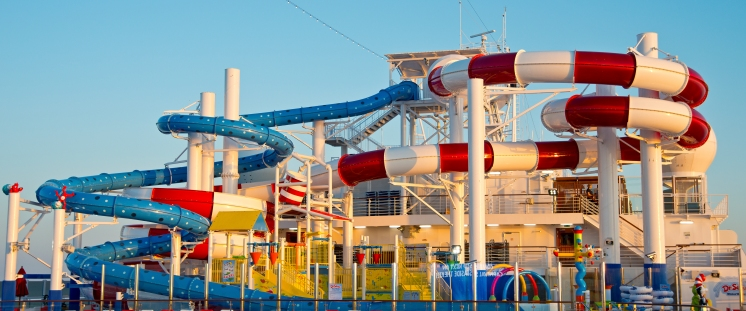 Bathed in afternoon light, the family-friendly Dr. Seuss WaterWorks Park, aboard Carnival Horizon, offers two lengthy slides and other water-based attractions for guests. Photo by Andy Newman/Carnival Cruise Line
