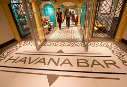 Guests aboard the Carnival Horizon exit the ship's Cuban-influenced Havana Bar. Photo by Andy Newman/Carnival Cruise Line
