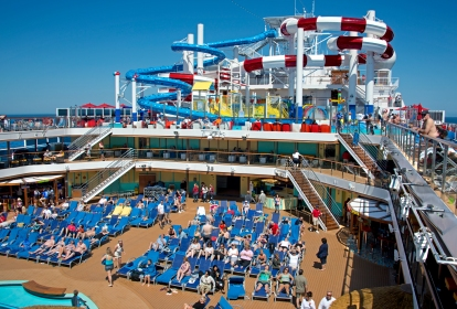 Guests aboard the Carnival Horizon relax on the Lido Deck, just below an upper deck that features the Dr. Seuss WaterWorks Park. Photo by Andy Newman/Carnival Cruise Line