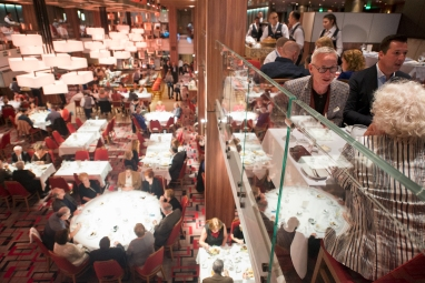"""Guests on the Carnival Horizon enjoy """"Your Time"""" dining in the ship's Meridian Dining Room, one of two main dining rooms aboard the cruise liner. Photo by Andy Newman/Carnival Cruise Line"""
