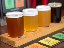 Four beer brews, made by Carnival Horizon Brewmaster Colin Presby include, from left, Toasted Amber, Farmhouse Ale, West Coast IPA and Smoked Porter. Photo by Andy Newman/Carnival Cruise Line