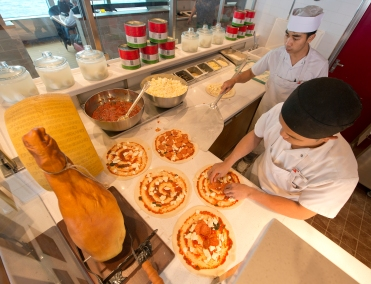 Chefs prepare pizzas on the Carnival Horizon in the Pizzeria Del Capitano, offering hand-tossed pizzas 24 hours a cruise day. Photo by Andy Newman/Carnival Cruise Line