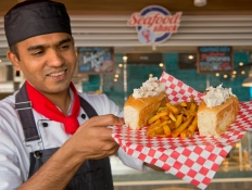 A chef shows off lobster rolls aboard the Carnival Horizon's Seafood Shack. Photo by Andy Newman/Carnival Cruise Line