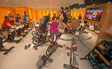 Guests aboard the Carnival Horizon boost their heart rate during a spinning class in the ship's Cloud 9 Spa. Photo by Andy Newman/Carnival Cruise Line