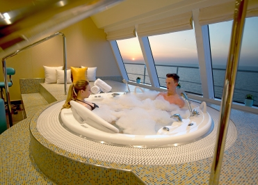 A couple aboard the Carnival Horizon enjoys the whirlpool in the ship's Cloud 9 Spa as the sun sets behind. Photo by Andy Newman/Carnival Cruise Line
