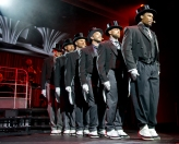 """Carnival Horizon singers/dancers perform """"Vintage Pop,"""" a Playlist Productions' revue that evokes the set of a speakeasy in the Great Gatsby and Cotton Club era. The show is led by a toe-tapping, live band in vibrant costumes and includes a burlesque number. Photo by Andy Newman/Carnival Cruise Line"""