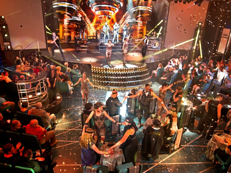 "Carnival Horizon singers/dancers interact with the audience during the finale for ""Vintage Pop,"" a Playlist Productions' revue that evokes the set of a speakeasy in the Great Gatsby and Cotton Club era. The show is led by a toe-tapping, live band in vibrant costumes and includes a burlesque number. Photo by Andy Newman/Carnival Cruise Line"